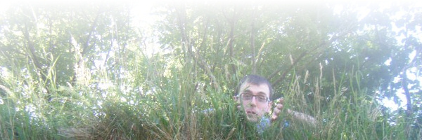 Me peeking through tall grass